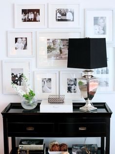 white frames w/white matting looks spectacular with black console, mercury glass lamp + black shade +great editing of accessories