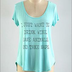 "I Just Want to Drink Wine Save Animals & Nap Short sleeve basic black t-shirt with scoop neck and rounded hem. ""I JUST WANT TO DRINK WINE, SAVE ANIMALS AND TAKE NAPS"" written across the front in black letters.  Perfect for a wine lover, animal lover and nap lover, so basically everyone! Makes a perfect gift. Such a fun graphic print top. This shirt gets so many laughs, so great to wear out!  96% rayon 4% spandex Made in USA Boutique Tops Tees - Short Sleeve"