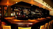 The Basin, Saratoga CA - the first 3 seats on the left to be precise.  Delicious locally-sourced food.  Best martini menu too!
