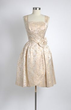 Will Steinman 1950's gold hued cream damask cocktail dress.  This would make a lovely wedding dress!