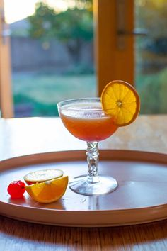 How to make a Tequila Sunrise cocktail with homemade grenadine using a simple combination of pomegranate juice, sugar, and orange peel. This simple cocktail makes a great brunch drink or easy-going sipper with tequila, orange juice and grenadine. #tequilasunrise #tequila #ad #cagrown #tequilacocktail