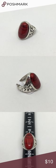 🆕Silver and Red Turquoise Fashion Ring A large silver fashion ring with a faux red turquoise stone, made from resin and ground turquoise to give it the depth and appearance of the real thing! Etched on either side. Ring size 8. NWT. Jewelry Rings