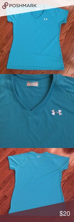 Under Armour turquoise V-neck Under Armour turquoise semi fitted hear gear V-neck performance tee. Turquoise blue Under Armour Tops Tees - Short Sleeve