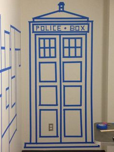 Painters tape TARDIS, this is an amazing youtube tutorial! And it has materialized in the big girls' room! Took me about 2 hours! Highly recommend cutting everything first...it makes everything go so much faster! Making this so I can paint it.