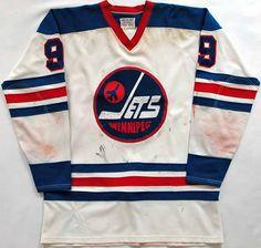 1974-75 Bobby Hull Winnipeg Jets WHA Game Worn Jersey - 50 Goals in 50 Games / 77 Goal MVP Season. Hockey Rules, Pro Hockey, Hockey Shirts, Hockey Room, Bobby Hull, Hockey Pictures, Ice Hockey Jersey, Vintage Jerseys, Sports Jerseys