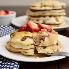Add strawberries, vanilla extract and chocolate chips to pancake mix to make neapolitan pancakes! What a great Idea!