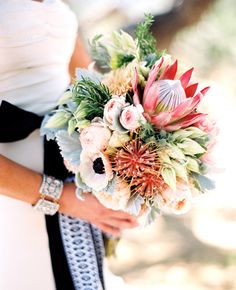 A chic-southwest inspired wedding..love huge protea, bridal protea, with romantic garden roses and anemones