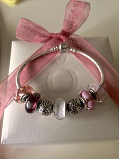 A tasteful Pandora collection of muted pinks, white faceted Murano and a little silver.  Understated.