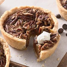 Everyone's favorite, pecan pie, lightened with golden syrup, and baked as individual mini pies.