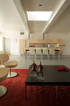 Apartment, Black Table Red Carpet Living Room Skylights Peach Chair Mini Sculpture Dining Set Bar Door And Marble Floor ~ Incredible Apartment Living Room Architecture with Glass Ceiling