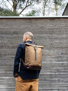The material I used to make this bag is British waxed canvas, it really is stunningly beautiful waxed canvas. The color is burned umber. I made it into an everyday backpack/rucksack, with leather straps and a leather closure with buckle, the bottom is made in oiled leather. Roll to close top. The side against the back is padded for more wear comfort. This rucksack is fully lined with a blue cotton fabric with padded laptop compartment All the bags are made and designed by myself and…