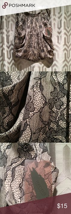 NWT!! Forever 21 Printed skirt Printed skirt. 100% polyester. Light purple / silver with black print. Forever 21 Skirts Mini