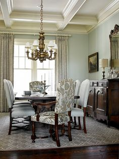 designed by T.S. Adams Studio. interiors: Mary McWilliams from Mary Mac & Co. Paint color is Farrow and Ball 235 Borrowed Light. Dining room features coffer ceiling. Ceiling Height: 10′ 4″.