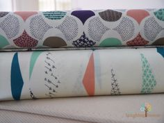 JUST ARRIVED: Pennants Waving & Scalloped Edge in Ivory from Cloud 9's KOI collection. Now available at Laughing House Fabric  http://laughinghousefabric.etsy.com/