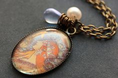 Zodiac Necklace. Alphonse Mucha Pendant with Glass Teardrop and Fresh Water Pearl. Oval Charm Necklace. Zodiac Jewelry. Handmade Jewellery. by StumblingOnSainthood from Stumbling On Sainthood. Find it now at http://ift.tt/1WkSIpA!