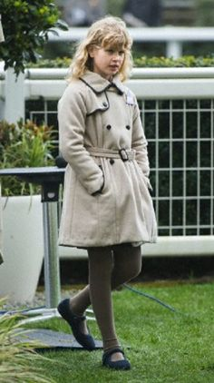 Lady Louise Windsor in a cream coat as she attends the 2013 Christmas meeting at Ascot Racecourse