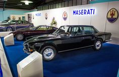 1st generation Quattroporte and a 1st generation Ghibli beside the latest Maserati models.