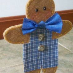 """Gingerbread Boy Blue by Karas Krafty Kreations in Dover, Ohio.  Measures 5 3/4"""" long and 4 1/2"""" wide."""