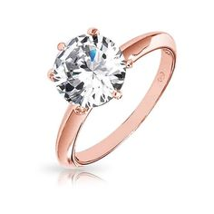 Bling Jewelry Rose Gold Vermeil Round Cut CZ Solitaire Engagement Ring... (£23) ❤ liked on Polyvore featuring jewelry, rings, pink, cz rings, bridal engagement rings, cocktail rings, bridal rings and cubic zirconia rings