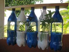 8 Stunning DIY Bottle Plant Design Ideas You Have - Jardin Vertical Fachada Plastic Bottle Planter, Plastic Bottle Crafts, Recycle Plastic Bottles, Vertical Garden Planters, Vertical Gardens, Garden Pots, Herb Garden, Garden Ideas, Diy Hanging Planter