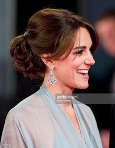 Kate is wearing same earrings her mother wore to Kate and William's wedding reception in 2011.  Catherine, Duchess of Cambridge attends the Royal Film Performance of  'Spectre' at Royal Albert Hall on October 26, 2015 in London, England.  (Photo by Mark Cuthbert/UK Press via Getty Images)