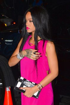 Rihanna in New York City on 8/18/14 - A punchy, fuchsia lip perfectly matches RiRi's Helmut Lang dress.