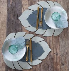 Green recycled leather made into Monstera leaf shaped placemats by Danish design brand LIND DNA. Create the perfect casual dinner setting. Tea Accessories, Interior Accessories, Recycled Leather, Leather Craft, Alice In Wonderland Drawings, Leather Coasters, Boho Baby Shower, Deco Table, Leaf Shapes