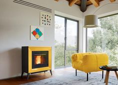 THELMA - A wood-burning with a strong character and a unique style. Large hand-finished panels surround the firebox. Pellet Stove, Wood Pellets, Upholstered Arm Chair, Wood Burner, Family Room, New Homes, Home Appliances, House Design, Interior Design