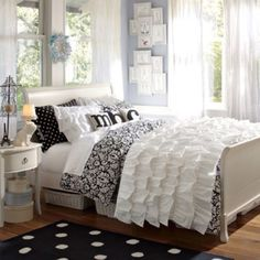 Cream furniture with black and white bedding