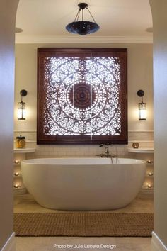 This bathroom remodeler went all in on the window covering and the solo bathtub. See some quick tips for remodeling your next bathroom by clicking on the Pin.