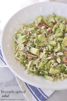 Brussels Sprout Salad is a fun and delicious way to eat your brussels sprouts. Dressed with a light citrus dressing.