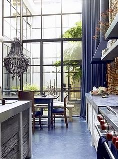 Just in love with the openness of this space, the soaring windows, and the eclectic mix of materials.