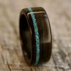 Ziricote Bentwood Ring with Offset Turquoise Inlay - Handcrafted Wooden Ring. $195.00, via Etsy.