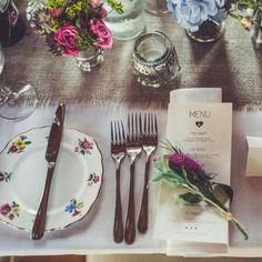 A country village hall decorated with the most gorgeous vintage china, deep pink flowers & rustic charm