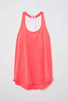 Loose-fit sports tank top in fast-drying jersey. Mesh at back mesh shoulder straps and racer back. Rosa Coral, Coral Pink, Sleeveless Tunic Tops, Pink Ladies, Basic Tank Top, Athletic Tank Tops, Rompers, Lady, Shirts