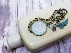 Mint green Though She Be but Little She is Fierce inspirational bracelet, A Midsummer Nights Dream, Shakespeare quote jewelry, bookish gift     Pretty link bracelet with lovely William Shakespeare quote And Though She Be Little She is but Fierce from the famous play A Mid Summer Nights Dream in light green with gold script writing. Dangling delicately from the end is a glass bead and patina green wing. The bronze chain is 7 inches long with a lobster clasp closure. The main pendant is 1 inch…