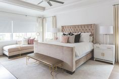 Pink and brown bedroom features a brown velvet tufted bed dressed in pink and black pillows flanked by white nightstands adorned with gold bamboo pulls, Worlds Away Marcus White & Gold Leaf Cabinet, and clear glass column lamps. White And Brown Bedroom, Pink Master Bedroom, Grey And Gold Bedroom, Velvet Bedroom, Brown Bedroom Decor, Luxurious Bedrooms, Interior Design Living Room, Tufted Bed, Black Pillows