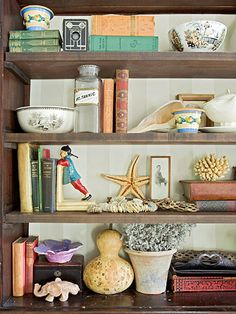 Fun family collections and flea market finds give this bookcase a distinct look: http://www.bhg.com/decorating/decorating-style/flea-market/decorate-with-vintage-finds/?socsrc=bhgpin031914displayyourfavorites&page=2