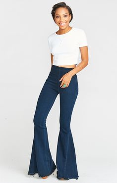 """The highest ranked pull on super flares are here and ready to set you ahead of the curve. Suck you in in all the right places with the perfect amount of stretch so you always feel free. FINALLY you have a pair of high waisted jeans to wear your collection of Mumu crop tops with, as well as everything else in your closet. *MADE IN THE GORGE USA* *69%Rayon, 29%Cotton, 2%Polyurethane *No pockets in front, 2 pockets in back *Stretchy elastic waist *Inseam: 36"""""""