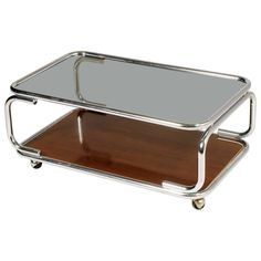 Mid-Century Modern Italy chrome serving trolley or coffee table, with smoked glass top with under faux laminated wood. Shop our full collection of Storage here at Vinterior Square Glass Coffee Table, Oval Coffee Tables, Coffee Table Design, Glass Table, Modern Glass, Mid-century Modern, Serving Trolley, Serving Table, Wood For Sale