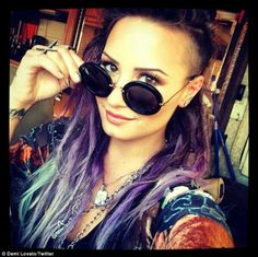 Well partially short:-) Cool look that works for her. Bold style: Demi shared a photo on Saturday of her new purple and blue dreadlocks saying '...