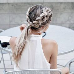 Two dutch braids become the a chic, low ponytail