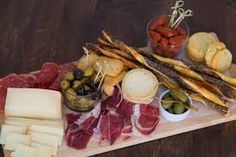 Inspired by a recent trip to Spain (and loaded up with some Spanish treats I brought home) I decided to make a Spanish charcuterie board. A mixture of ham, crackers, cheese and some other goodies, this board is a hit when you have a few friends over. Cold Appetizers, Italian Appetizers, Spanish Cuisine, Spanish Food, Spanish Dinner, Spanish Party, Food N, Food And Drink, Meat And Cheese Tray