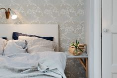 Cozy and intimate bedroom close-up. Using a small shelf as a nightstand is also very clever! Photo taken in a Gothenburg apartment.