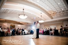 Newcastle Golf Club Wedding bride and grooms first dance inside ballroom