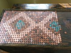 He used the different colored pennies to make a unique pattern.