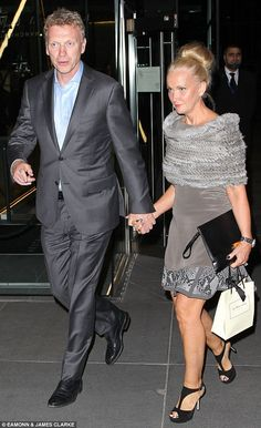 at the end of the meal United manager Moyes leaves with his wife