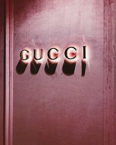 Pink velvet wall & neon gucci what's not to love!