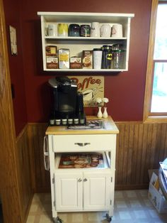 Original idea from http://ournavylife.blogspot.com/2012/07/diy-coffee-bar.html  I already had the kitchen cart and my mom provided me with the shelf. I stripped and painted the shelf. It's not as fancy as the one I pinned but I'm not 100% finished with it yet.