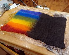 """amusementcell: """"From start to finish: striped rainbow socks. For this project, I knitted a sock blank using two strands of yarn, dyed the blank half-black, half-rainbow, and knitted a pair of socks..."""